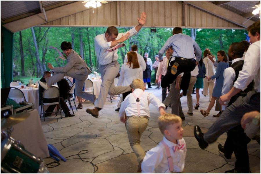 groom and groomsmen dancing at wedding reception, rustic wedding photographers