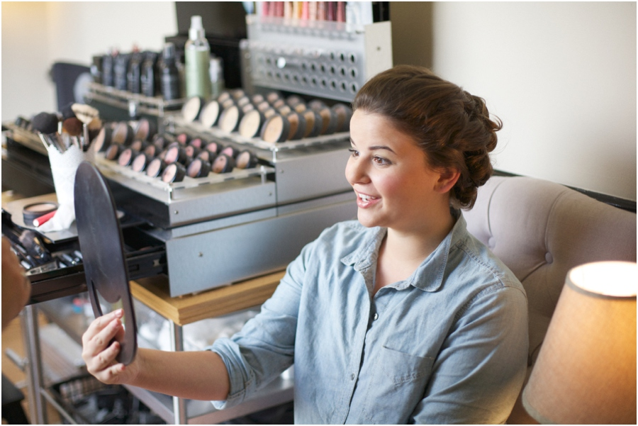 bride getting makeup done, raleigh nc wedding photographers