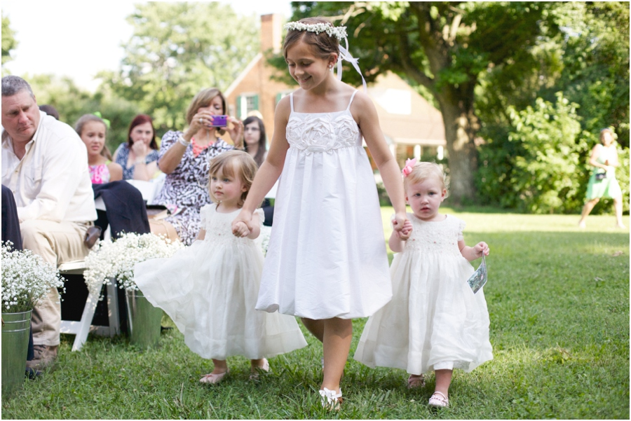 flower girls walking up the aisle at outdoor wedding, southern wedding photography