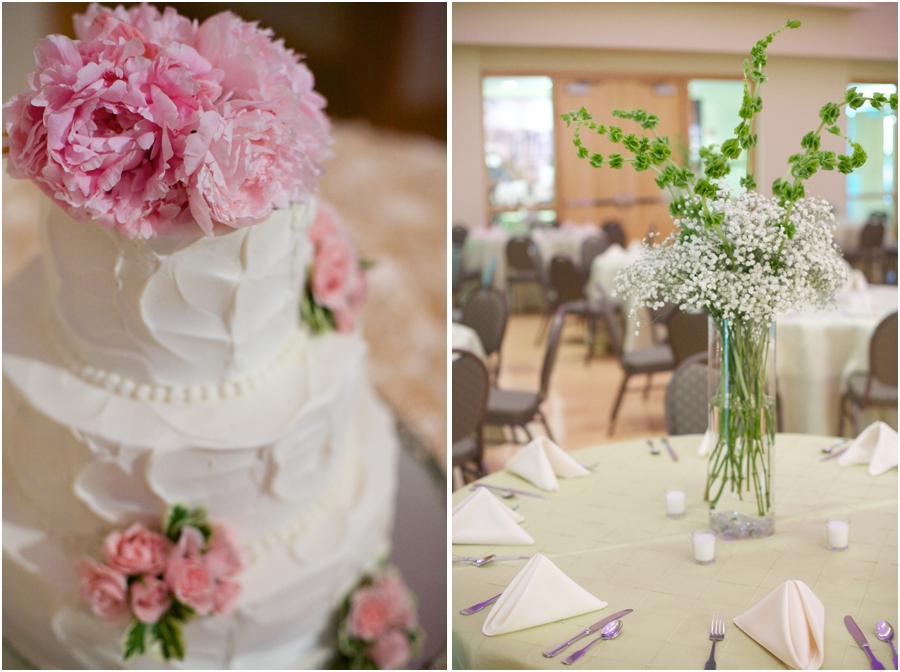 creamy wedding cake decorated with fresh pink flowers, tall floral table centerpieces at wedding reception