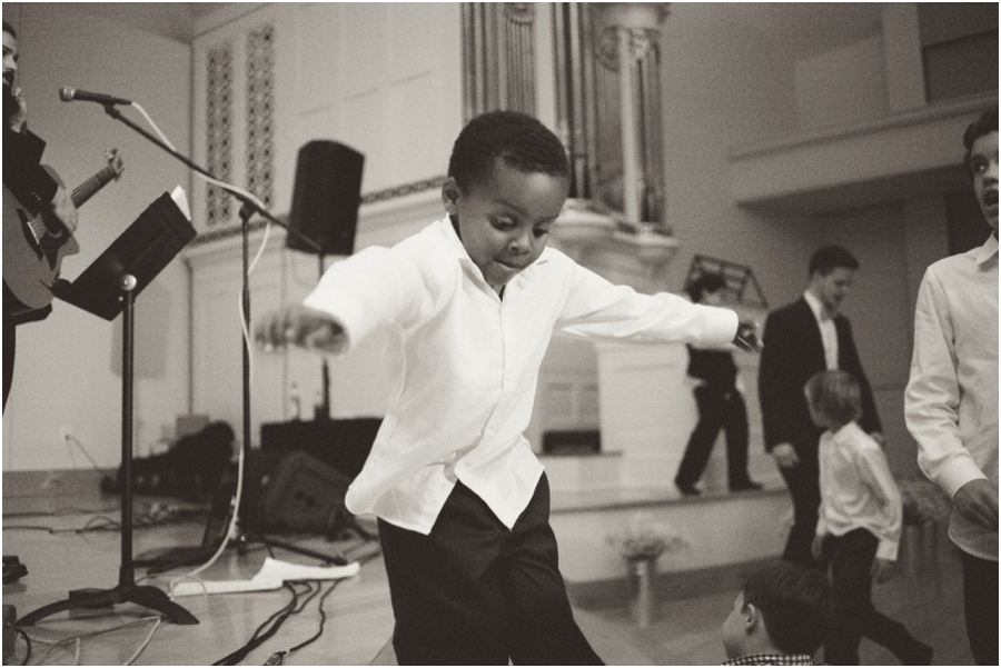 little boy jumping, fun wedding reception photography