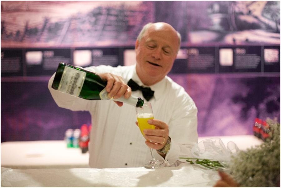 bartender pouring a drink, old salem wedding photographers