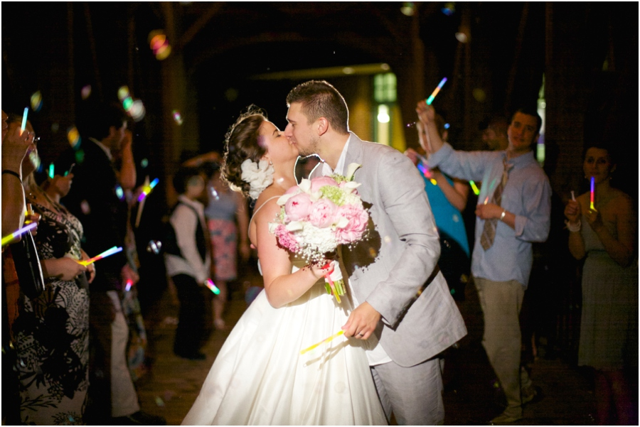 bride and groom exiting to a fun glowstick and bubble sendoff, winston salem nc wedding photographers