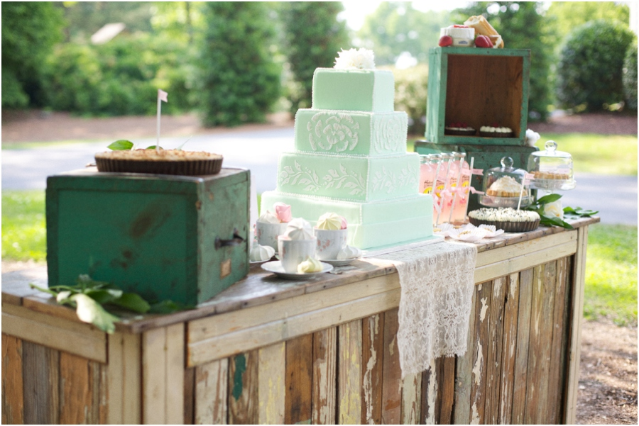 reception bar laden with mini and full-size pies, colorful meringues in vintage tea cups, assorted sweets, and a gorgeous mint and lace cake designed by Linacucina