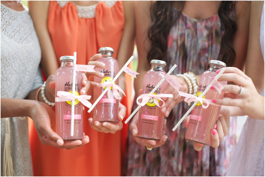 southern bridesmaids holding out bottles of pink lemonade, summer bridal luncheon, vintage wedding photographers