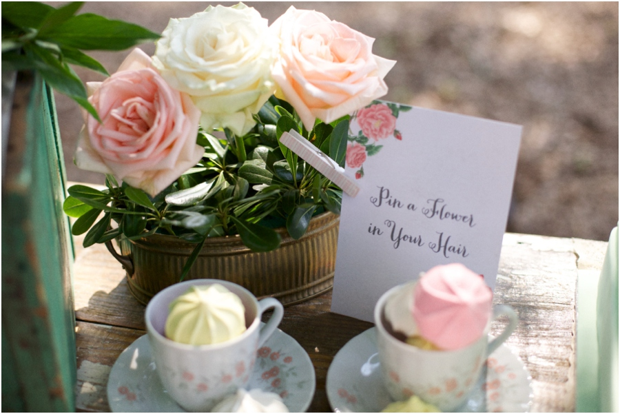 'pin a flower in your hair' bar at bridal luncheon with blush pink, cream, and peach roses