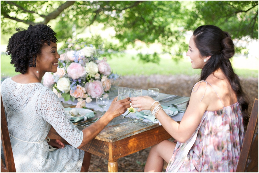 beautiful southern photography, friends clink glasses at summer bridal luncheon, vintage wedding photographers