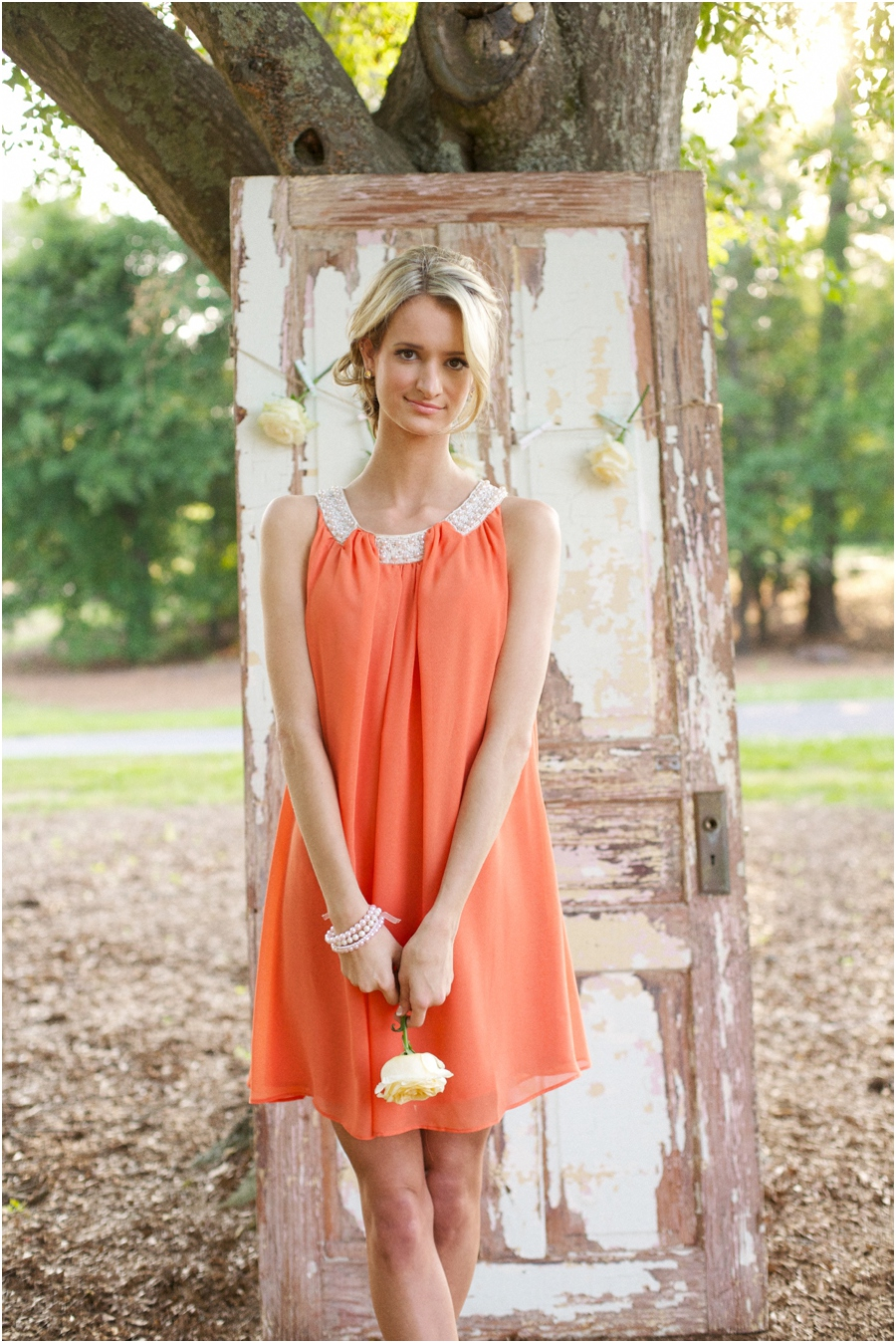 bridesmaid in cute coral dress, summer editorial photography