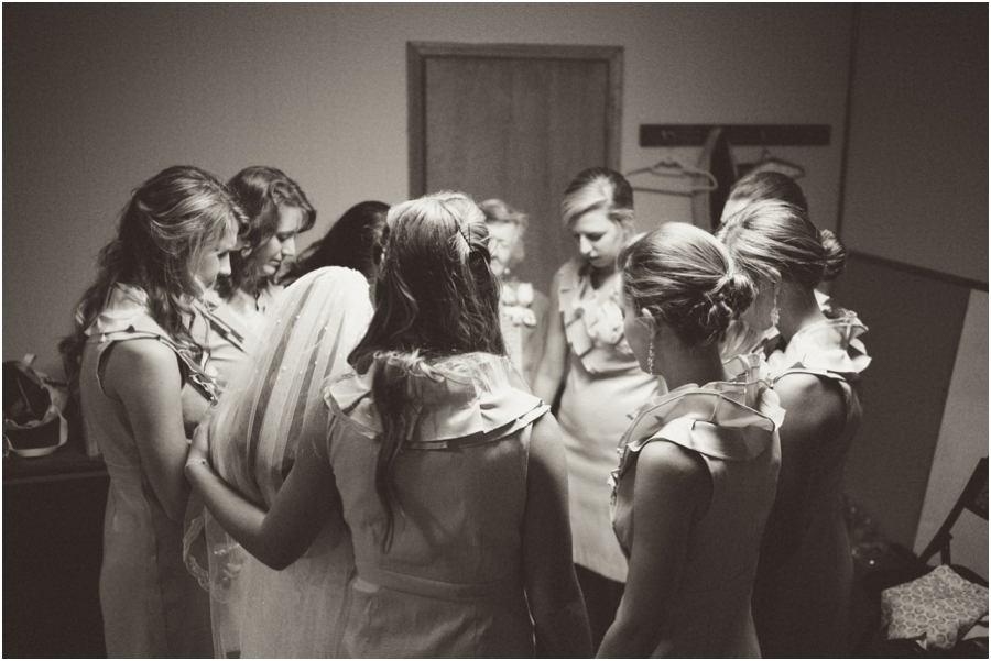 bridesmaids praying with bride before the ceremony, southern wedding photographers, raleigh nc