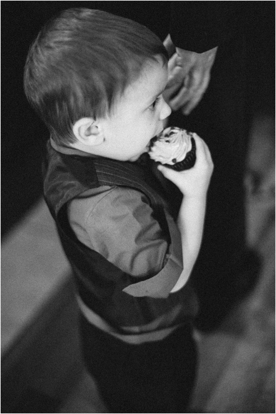 little boy taking a bite of his cupcake at southern wedding reception