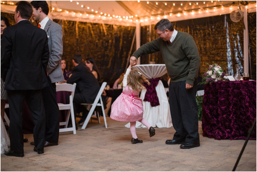 little girl dancing with her daddy at wedding reception