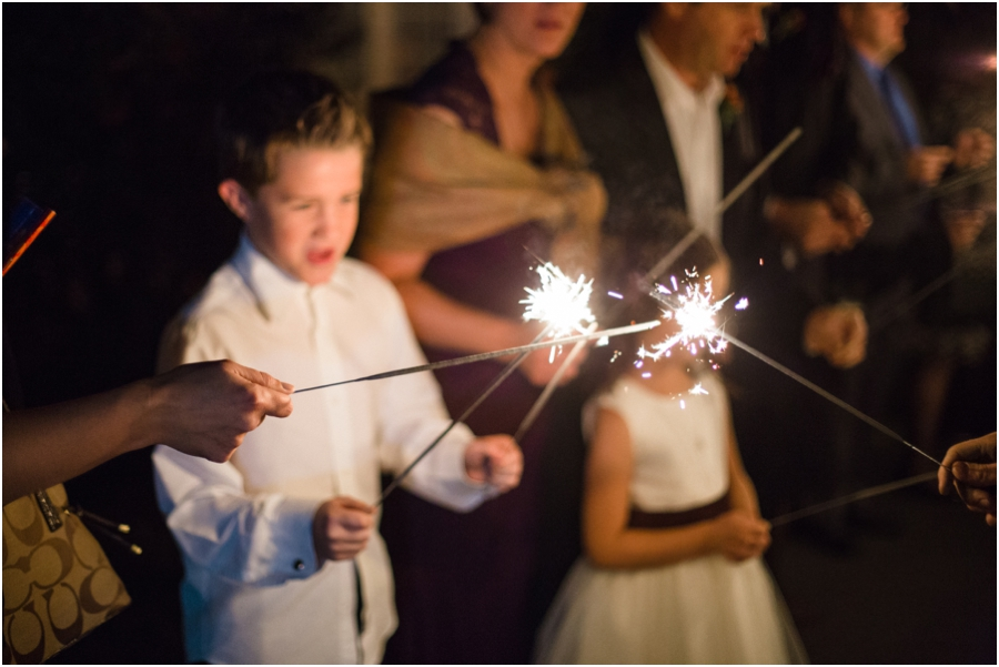 guests lighting sparklers, southern wedding photographers