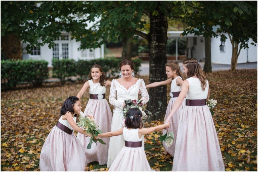 junior bridesmaids dancing around the bride, bohemian bridal photography
