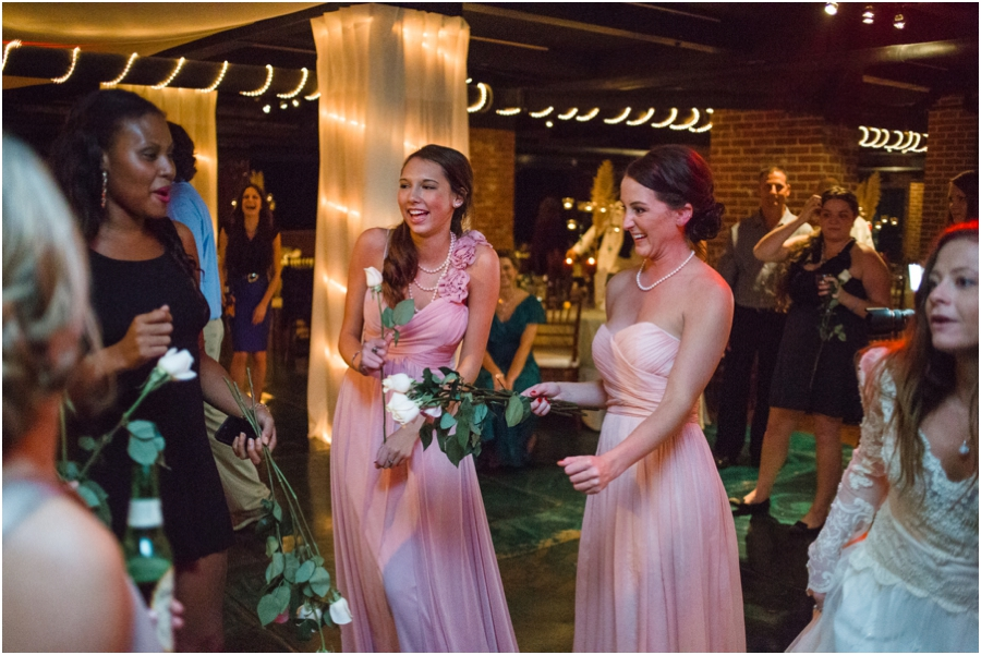 every girl got a flower when the bride threw a bunch of roses instead of her bouquet