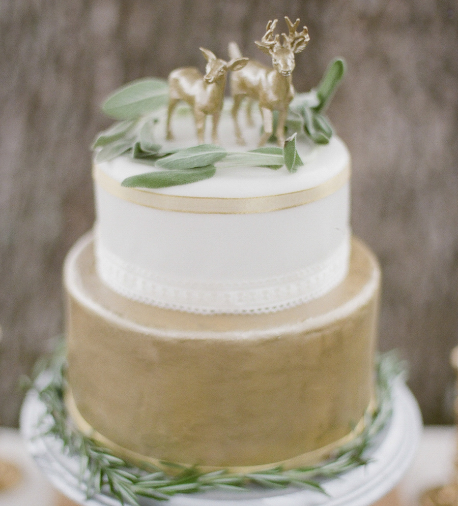 bohemian gold and green cake with deer topper